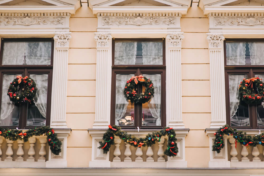 Wreaths hanging in windows