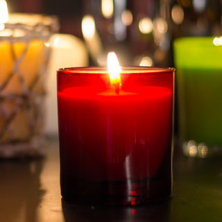 Winter Candle in Red Glass